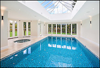BNPS.co.uk (01202 558833)<br /> Pic: Sothebys/BNPS<br /> <br /> ***Please use full byline***<br /> <br /> Leyton House on the Crown Estate near Oxshott boasts indoor swimming pool and spa complex as well as parking for 6-8 cars. It is on the market for &pound;6.85m. Built this year - 2014. <br /> <br /> To the Manor Reborn...<br /> <br /> Britain's super rich are turning their backs on the decaying stately piles beloved by the aristocracy and building brand new modern mansions on their country estates.<br /> <br /> Rather than investing in the leaky roofs and draughty windows of days gone by, modern millionaires are choosing to build plush pads from the ground up.<br /> <br /> And they are filling their dream homes with every conceivable luxury without the need for a bottomless sink fund to pay for the costly upkeep of older houses.<br /> <br /> Estate agents specialising in top-end properties have reported a clear swing from grand Victorian manor houses to state of the art modern homes kitted out with all the mod cons.<br /> <br /> The multi-million pounds properties have been popping up across the country over the past few years - and are now being heralded as the stately homes of the future.