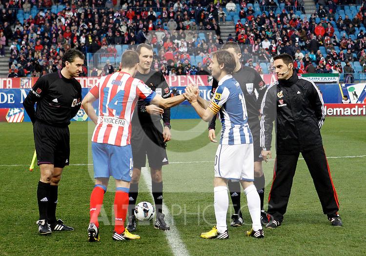 Referee Clos Gomez, Atletico de Madrid's Captain Gabi Fernandez and  and Espanyol's Captain Verdu during La Liga  match. February 24,2013.(ALTERPHOTOS/Alconada)