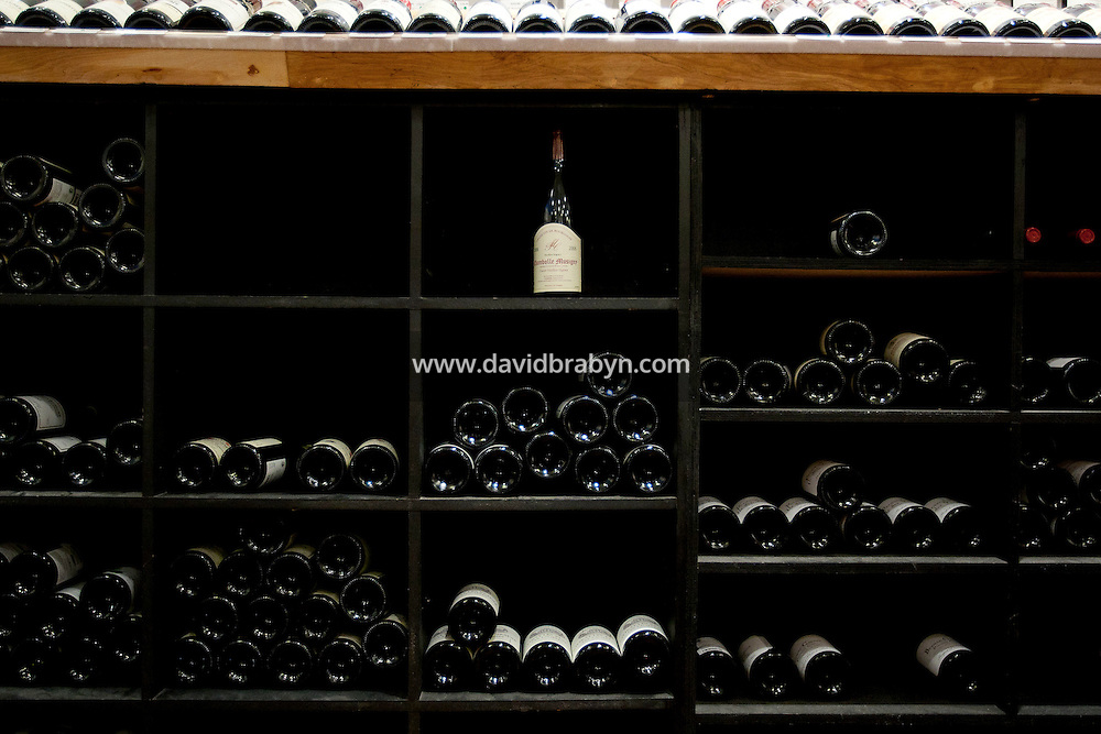 Bottles sit on shelves inside Chambers Street Wines in New York, NY, USA, 22 May 2009. The store specializes in naturally made wines from artisanal small producers and has received a Slow Food NYC Snail of Approval.