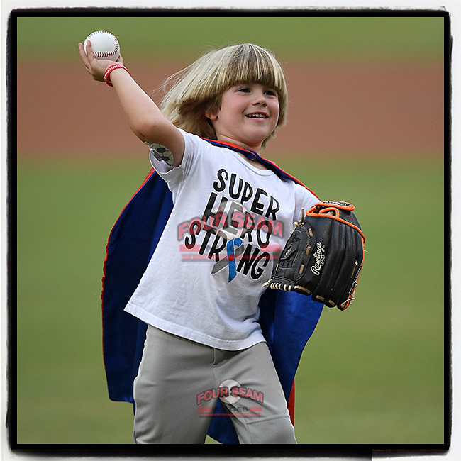 Dressed as a super hero, Beckham Knecht, representing the Juvenile Diabetes Research Foundation, throws out a ceremonial first pitch at a game between the Greenville Drive and Asheville Tourists on Friday, August 23, 2019, at Fluor Field at the West End in Greenville, South Carolina. (Tom Priddy/Four Seam Images) #MiLB