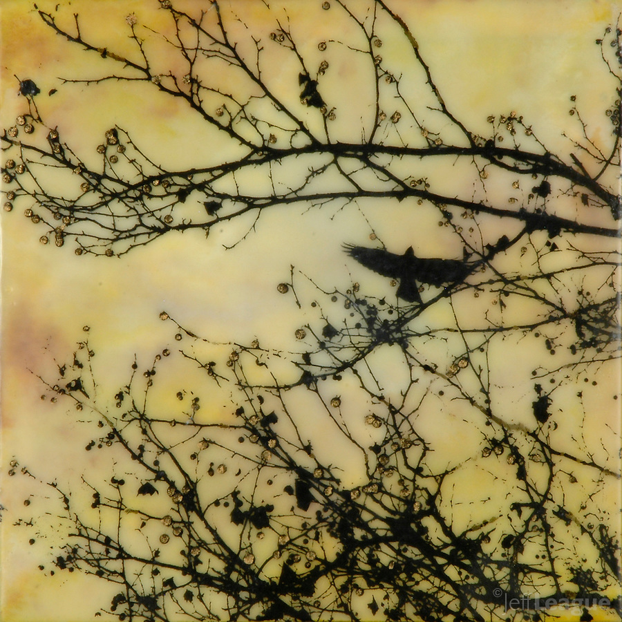 Crow in branch with berries silhouette photo transfer over encaustic painting of yellow sky.