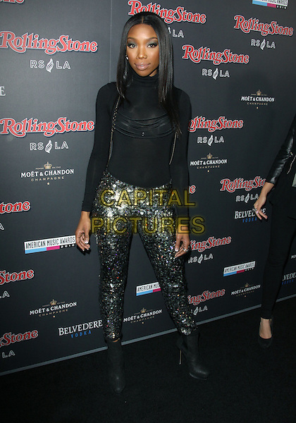 BRANDY NORWOOD.American Music Awards After Party Hosted By Rolling Stone Magazine held Rolling Stone Restaurant And Lounge, Hollywood, CA, USA..November 21st, 2010.AMA AMAS AMA'S full length black top silver trousers sequins sequined boots high collar .CAP/ADM/TC.©T. Conrad/AdMedia/Capital Pictures.