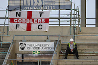 A construction worker looks on during the Sky Bet League 2 match between Northampton Town and Morecambe at Sixfields Stadium, Northampton, England on 23 January 2016. Photo by David Horn / PRiME Media Images.
