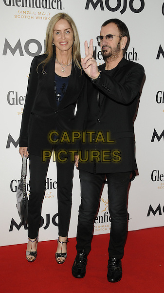 BARBARA BACH & RINGO STARR.The Glenfiddich MOJO Honours List award ceremony, the Brewery, Chiswell St., London, England..July 21st, 2011.full length couple beard facial hair sunglasses shades jeans denim black jacket top hand v peace sign.CAP/CAN.©Can Nguyen/Capital Pictures.