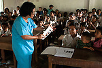 Nurse Channy from the Angkor Children's Hospital teaches a lesson in preventiive eye care to students at the Kok Thnot Commune Village Shool.