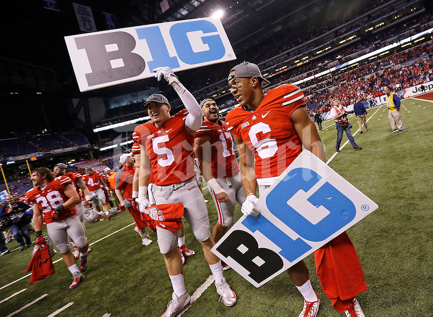 Ohio State Buckeyes tight end Jeff Heuerman (5) and Ohio State Buckeyes wide receiver Evan Spencer (6) hold Big Ten signs as they celebrate following their 59-0 win over the Wisconsin Badgers in the Big Ten Championship game at Lucas Oil Stadium in Indianapolis on Dec. 6, 2014. (Adam Cairns / The Columbus Dispatch)