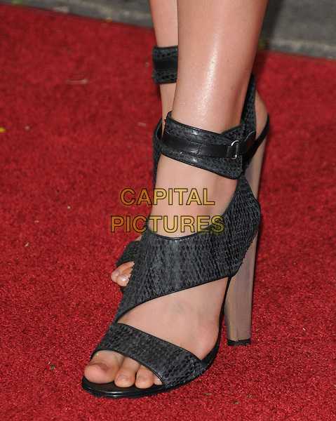 "JESSY SCHRAM .attends the Twentieth Century Fox's L.A. Premiere of ""Unstoppable"" held at Regency Village Theater in Westwood, California, USA, October 26th 2010..detail feet snake grey gray black open toe sandals cut out .CAP/RKE/DVS.©DVS/RockinExposures/Capital Pictures."