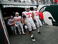 Ohio State Buckeyes guard Michael Jordan (73), offensive lineman Branden Bowen (76) and Ohio State Buckeyes head coach Urban Meyer take the field for warm ups prior to the NCAA football game against the Michigan State Spartans at Spartan Stadium in East Lansing, Mich. on Nov. 10, 2018. [Adam Cairns/Dispatch]