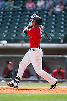 Danny Hayes (9) of the Birmingham Barons follows through on his swing against the Tennessee Smokies at Regions Field on May 4, 2015 in Birmingham, Alabama.  The Barons defeated the Smokies 4-3 in 13 innings. (Brian Westerholt/Four Seam Images)