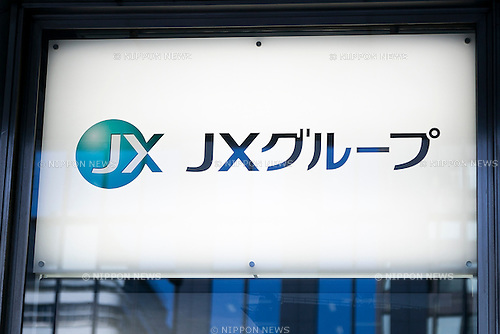 JX Holdings signboard on display at the entrance of its building in Tokyo, Japan on December 4, 2015. Japan's largest oil refiner and wholesaler JX Holdings Inc., which operates ENEOS gas stations, is continuing talks to finalize the acquisition of competitor TonenGeneral Sekiyu by the end of this year. The companies have combined sales of 14 trillion yen ($113 billion) and plan a share swap in the latest move towards consolidating their businesses by 2017. JX Holdings operates 14,000 ENEOS gas stations and TonenGeneral operates Esso, Mobil and General brand gas stations. Together they represent around 40% of all stations in Japan. (Photo by Rodrigo Reyes Marin/AFLO)
