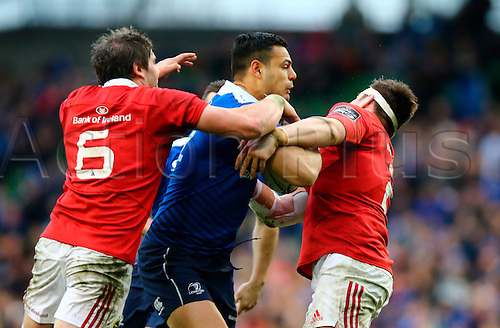 02.04.2016. Aviva Stadium, Dublin, Ireland. Guinness Pro12.  Leinster versus Munster. Ben Te'o (Leinster) is tackled by Dave O'Callaghan (Munster) and Niall Scannell (Munster).