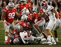 The Ohio State defense brings down Indiana Hoosiers quarterback Reese Taylor (2) during the second half of the NCAA football game between the Ohio State Buckeyes and the Indiana Hoosiers at Ohio Stadium on Saturday, October 6, 2018. [Jonathan Quilter/Dispatch]