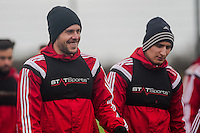 SWANSEA, WALES - JANUARY 28:  ( L-R )  Gylfi Sigurosson of Swansea City and Jonjo Shelvey of Swansea City make their way to training  on January 28, 2015 in Swansea, Wales.