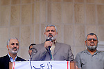 Palestinian Prime Minister of Hamas Ismail Haniya (C) delivers speech as the injured palestinians from the war-ravaged in the Israeli military offensive in the Gaza Strip protest in Gaza City on October 14, 2009, against the President Mahmoud Abbas' decision to withdraw support for a U.N. report that alleged Israel and Hamas committed war crimes in last winter's Gaza war. Palestinian President Mahmoud Abbas faced growing outrage over his decision to withdraw support for a U.N. report that alleged Israel and Hamas committed war crimes in last winter's Gaza war. Photo by Mohammed Asad