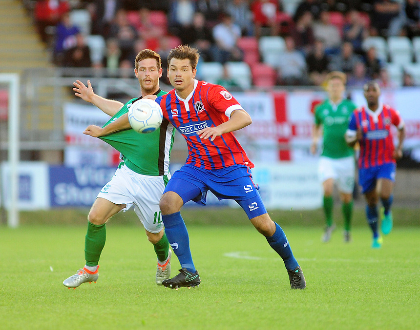 Lincoln City's Adam Marriott vies for possession with Dagenham and Redbridge's Craig Robson<br /> <br /> Photographer Andrew Vaughan/CameraSport<br /> <br /> Football - Vanarama National League - Dagenham &amp; Redbridge v Lincoln City - Tuesday 16th August -  Chigwell Construction Stadium - London<br /> <br /> World Copyright &copy; 2016 CameraSport. All rights reserved. 43 Linden Ave. Countesthorpe. Leicester. England. LE8 5PG - Tel: +44 (0) 116 277 4147 - admin@camerasport.com - www.camerasport.com