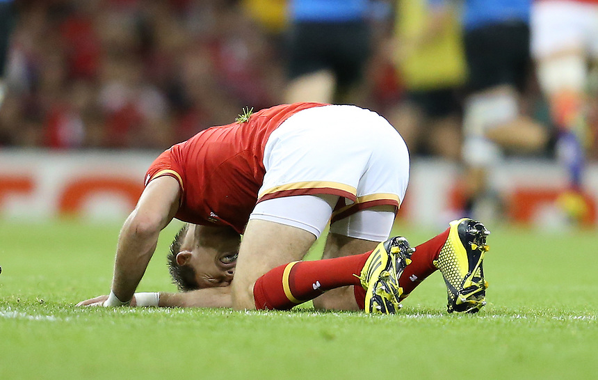 Wales' Liam Williams goes down injured <br /> <br /> Photographer Ian Cook/CameraSport<br /> <br /> Rugby Union - 2015 Rugby World Cup - Wales v Uruguay - Sunday 20th September 2015 - Millennium Stadium - Cardiff<br /> <br /> &copy; CameraSport - 43 Linden Ave. Countesthorpe. Leicester. England. LE8 5PG - Tel: +44 (0) 116 277 4147 - admin@camerasport.com - www.camerasport.com