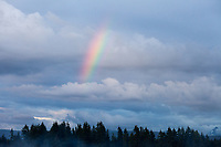 Rainbow and cloudy skies, Arlington, WA, USA.