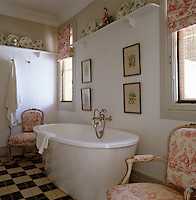 The contemporary guest bathroom is furnished with Louis XVI chairs upholstered in toile de Jouy