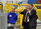 United States President Barack Obama (R) tours Orion Energy Systems, Inc. with founder and CEO Neal Verfuerth (C) in Manitowoc, Wisconsin on Wednesday, January 26, 2011. President Obama, Vice President Joe Biden and other members of the President's Cabinet traveled across the country Wednesday to highlight the administration's efforts to rebuild the American economy. .Credit: Brian Kersey / Pool via CNP