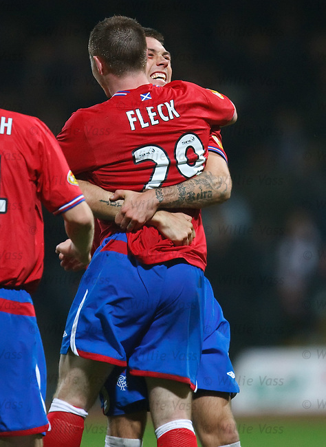 John Fleck celebrates his goal for Rangers with Jordan McMillan