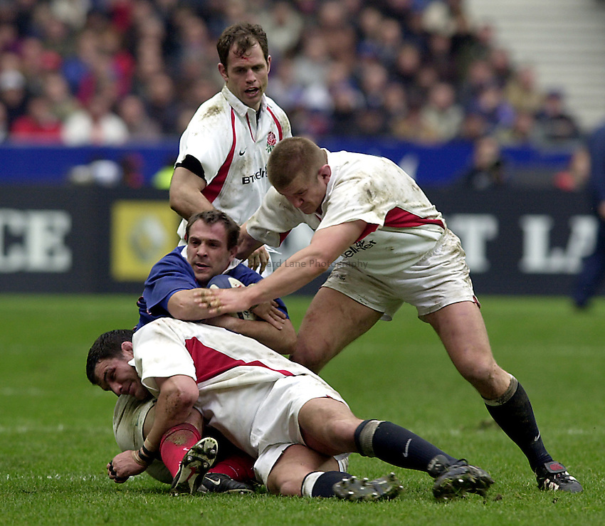 Photo.Richard Lane.France v England at Stade de France. 2-3-2002. Lloyds TSB Six Nations Championship..David Bory is tackled by Martin Johnson and Graham Rowntree.