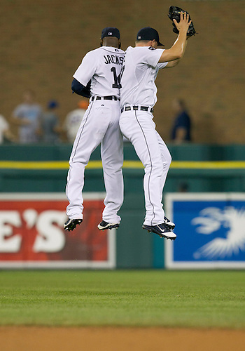 July 19, 2011:  Detroit Tigers center fielder Austin Jackson (left) and right fielder Casper Wells (right) celebrate victory after MLB game action between the Oakland Athletics and the Detroit Tigers at Comerica Park in Detroit, Michigan.  The Tigers defeated the Athletics 8-3.