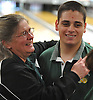 Chris Vietri of Holy Trinity gets congratulated by coach Mary Messina after winning the NYSCHSAA boys bowling individual championship at AMF Babylon Lanes on Saturday, Mar. 5, 2016. He rolled a four-game series of 982. As a top five finisher (second place) in the tournament, he qualified for a step ladder format playoff which he won to claim the Catholic state crown.