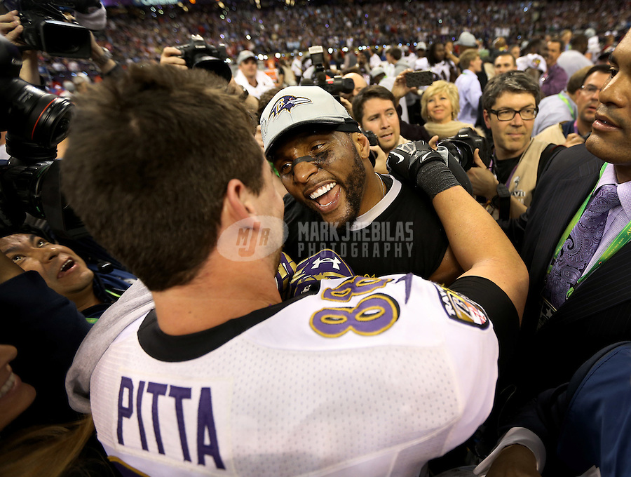 Feb 3, 2013; New Orleans, LA, USA; Baltimore Ravens inside linebacker Ray Lewis (middle) celebrates with teammate Dennis Pitta (88) after defeating the San Francisco 49ers in Super Bowl XLVII at the Mercedes-Benz Superdome. Mandatory Credit: Mark J. Rebilas-