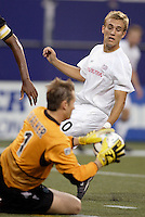 The MetroStars' goalkeeper Jonny Walker intercepts a cross from the Revolution's Taylor Twellman. The New England Revolution were defeated by the MetroStars 3 to 2 on Saturday September 11, 2004 at Giant's Stadium, East Rutherford, NJ..