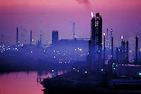 Smog shrouds a Houston oil refinery, Houston, Texas