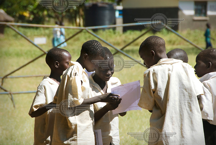 School children get their end of term results.