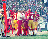 Washington Redskins quarterback Sonny Jurgensen (9) discusses strategy during the game against the Miami Dolphins at RFK Stadium in Washington, DC on October 13, 1974.  The Redskins won the game 20 - 17.<br /> Credit: Arnie Sachs / CNP