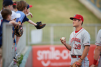 Chattanooga Lookouts Brantley Bell (28) talks with young fans during warmups before a Southern League game against the Birmingham Barons on May 2, 2019 at Regions Field in Birmingham, Alabama.  Birmingham defeated Chattanooga 4-2.  (Mike Janes/Four Seam Images)