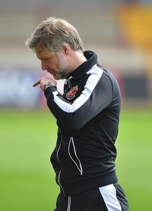 Fleetwood Town's Manager Steven Pressley kisses his wedding ring in relief of avoiding relegation<br /> <br /> Photographer Dave Howarth/CameraSport<br /> <br /> Football - The Football League Sky Bet League One - Fleetwood Town v Crewe Alexandra - Sunday 8th May 2016 - Highbury Stadium - Fleetwood    <br /> <br /> &copy; CameraSport - 43 Linden Ave. Countesthorpe. Leicester. England. LE8 5PG - Tel: +44 (0) 116 277 4147 - admin@camerasport.com - www.camerasport.com