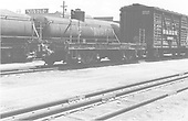 End side view of idler car #01097 with stock car #39421 and mixed equipment at Alamosa<br /> D&amp;RGW  Alamosa, CO