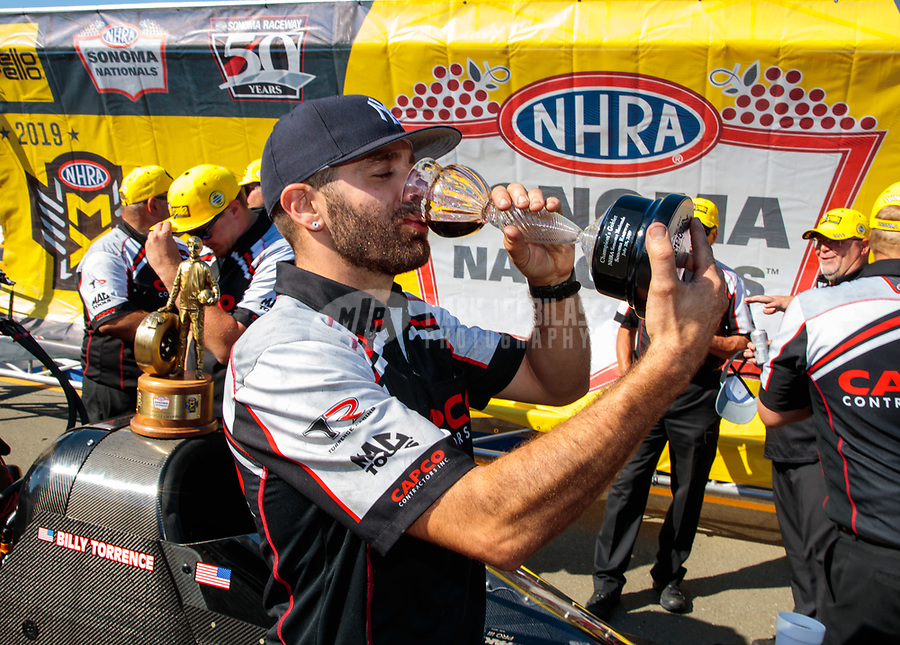 Jul 28, 2019; Sonoma, CA, USA; Dom Lagana, crew member for NHRA top fuel driver Billy Torrence celebrates after winning the Sonoma Nationals at Sonoma Raceway. Mandatory Credit: Mark J. Rebilas-USA TODAY Sports
