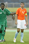 07 August 2008: Onyekachi Apam (NGA) (4) keeps touch of Roy Makaay (NED) (9) before a Netherlands corner kick.  The men's Olympic soccer team of the Netherlands played the men's Olympic soccer team of Nigeria at Tianjin Olympic Center Stadium in Tianjin, China in a Group B round-robin match in the Men's Olympic Football competition.