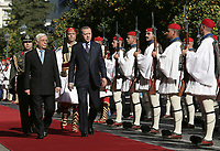 Pictured: (L-R) Greek President Prokopis Pavlopoulos escorts Turkey President Recep Tayyip Erdogan past a row of Presidential Guards known as Tsoliaded, to the official Presidential Mansion <br /> Re: Turkey's president Recep Tayyip Erdogan has begun a landmark visit to Greece. Thursday 07 December 2017