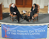 Washington, DC - May 3, 2009 -- Leon Wieseltier, literary editor of The New Republic, left, listens as former United States Secretary of State Condoleezza Rice, right, speaks to supporters of the the Jewish Primary Day School (JPDS) of the Nation's Capital in Washington, D.C. on Sunday, May 3, 2009 at the 6th and I Historic Synagogue..Credit: Ron Sachs / CNP