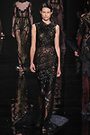 "Model walks runway in a black mélange lace column dress with bordeaux lace underlay from the Reem Acra Fall 2016 ""The Secret World of The Femme Fatale"" collection, at NYFW: The Shows Fall 2016, during New York Fashion Week Fall 2016."
