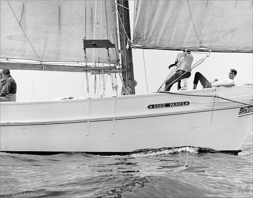 "Chesapeake Bay workboat Rosie Parks' crew enjoy her turn of speed as she slips through the glistening bay waters, unmatched in beauty or speed, and sails to victory in the 1967 Deal Island Skipjack race. Photograph from the restored Limited Edition Skipjack print in the Fine Art ""Skipjack Sunday"" collection."