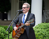 "American Christian music singer and songwriter Steven Curtis Chapman performs prior to United States President Donald J. Trump signing a Proclamation designating May 4, 2017 as a National Day of Prayer and an Executive Order ""Promoting Free Speech and Religious Liberty"" in the Rose Garden of the White House in Washington, DC on Thursday, May 4, 2017.<br /> Credit: Ron Sachs / CNP"