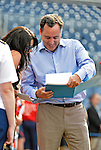 15 June 2012: Washington Nationals Chief Operating Officer Andrew Feffer checks out some photographs during batting practice prior to a game against the New York Yankees at Nationals Park in Washington, DC. The Yankees defeated the Nationals 7-2 in the first game of their 3-game series. Mandatory Credit: Ed Wolfstein Photo