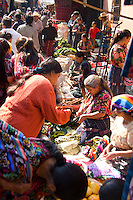 Local vendor women in colorful printed clothes in shopping center on market day in village of Chichicastenango Guatemal