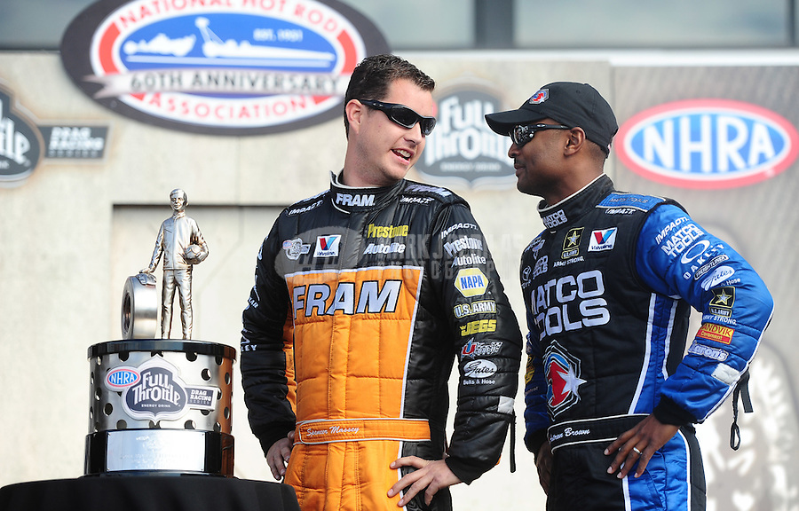 Nov. 13, 2011; Pomona, CA, USA; NHRA top fuel dragster driver Spencer Massey (left) and Antron Brown with the championship trophy during the Auto Club Finals at Auto Club Raceway at Pomona. Mandatory Credit: Mark J. Rebilas-.