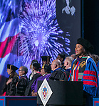 Diana Muhammad, Class of 2018, sings the national anthem during the DePaul University College of Law commencement ceremony, Sunday, May 13, 2018, at the McCormick Place Grand Ballroom in Chicago, IL. Approximately 280 students received their Juris Doctors or Master of Laws degrees. (DePaul University/Jamie Moncrief)