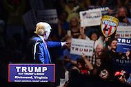 Richmond, VA - June 10, 2016:  Republican presidential candidate and businessman Donald J. Trump acknowledges supporters before speaking at a campaign rally at the Richmond Coliseum in Richmond, VA, June 10, 2016. Trump is the presumptive nominee for his party, having won the required number of delegates.  (Photo by Don Baxter/Media Images International)