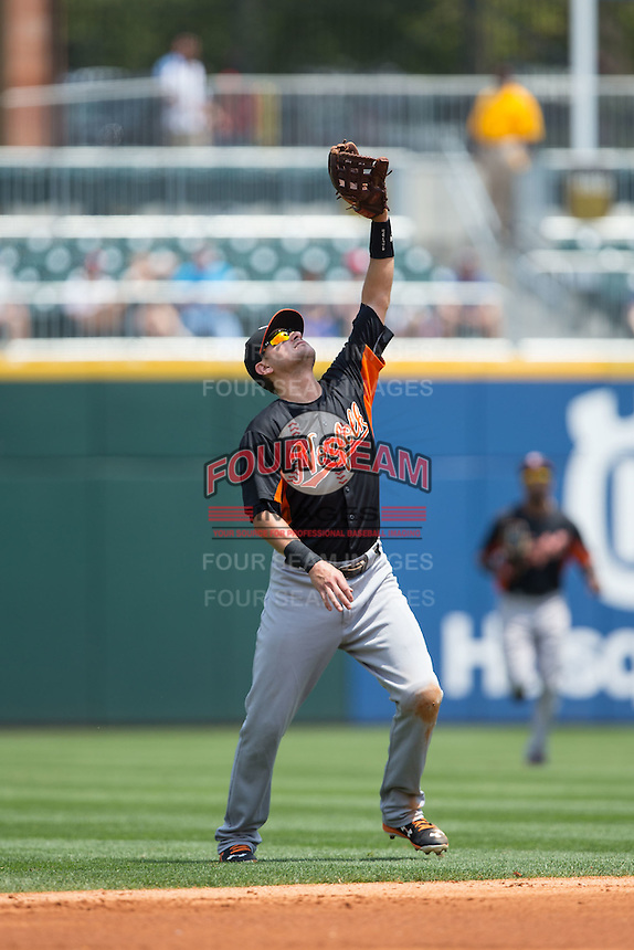 Norfolk Tides shortstop Paul Janish (11) tracks a pop fly during the game against the Charlotte Knights at BB&T BallPark on June 7, 2015 in Charlotte, North Carolina.  The Tides defeated the Knights 4-1.  (Brian Westerholt/Four Seam Images)