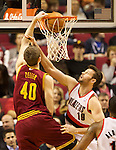 01/15/13--Cleveland Cavaliers center Tyler Zeller (40) slam ducks the ball against Portland Trail Blazers center Joel Freeland (19) in the first half at Moda Center.<br />