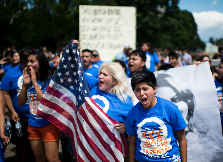 UNITED STATES - JULY 28: Immigration reform protesters with United We Dream chant in front of the White House to illustrate the stories of immigrant families on Monday July 28, 2014. (Photo By Bill Clark/CQ Roll Call)